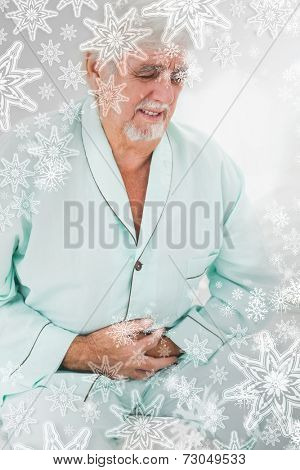 Man with pain in stomach against snowflakes on silver