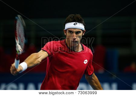 SEPTEMBER 25, 2014 - KUALA LUMPUR, MALAYSIA: Leonardo Mayer of Argentina reacts after making a backhand return in his match at the Malaysian Open Tennis 2014. This is an ATP sanctioned tournament.
