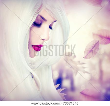 Autumn woman portrait. Fantasy Autumn girl with long white hair and fashion makeup. Fall.Falling leaves. Melancholy