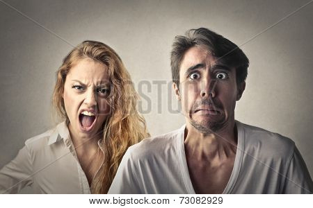 Angry woman shouting and fearful man