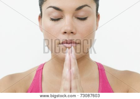 Close up of teen girls face while meditating