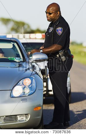 Policeman talking to stopped driver