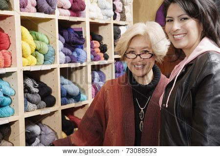 Two women together in yarn shop