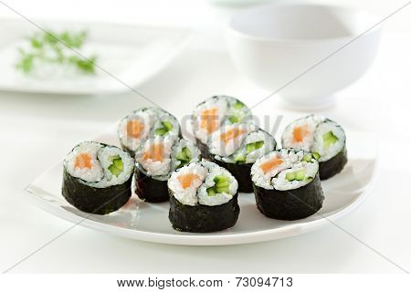 Yin Yang Maki Sushi - Roll made of Fresh Salmon and Cucumber inside. Nori Outside poster