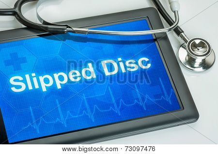 Tablet with the text Slipped disc on the display
