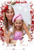 Mother and daughter baking in the kitchen against christmas themed frame poster