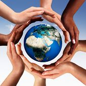 Conceptual peace and cultural diversity symbol of multiracial hands making a circle together around the world the Earth globe on blue sky background. Elements of this image furnished by NASA. poster