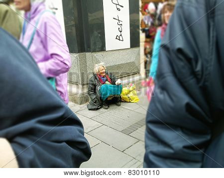 Old Grey-haired Woman Beggar