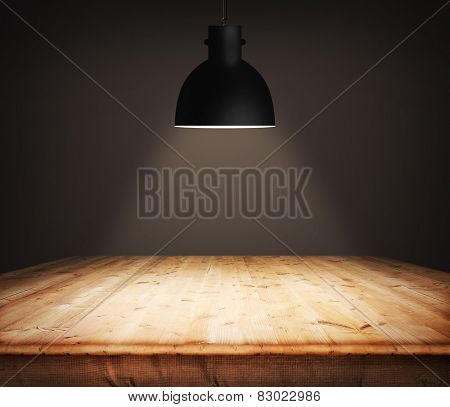 Empty wooden table and black plafond above