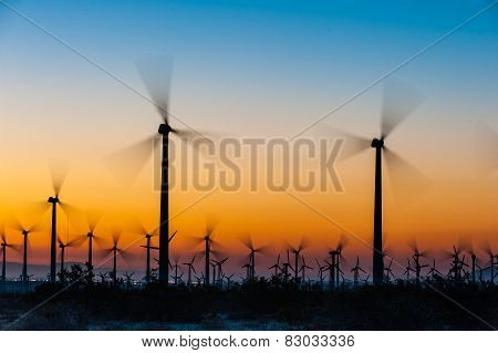 Wind Turbines In Desert During Sunrise Time