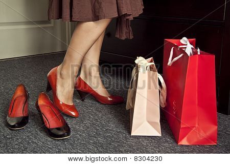 Legs, women's shoes, and bags