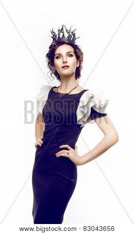 Studio Portrait Of A Beautiful Brunette With A Crown
