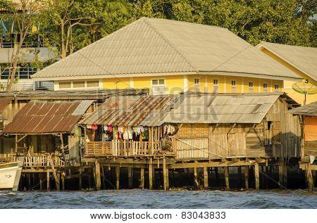 Rundown homes by Chao Praya River in Bangkok, Thailand