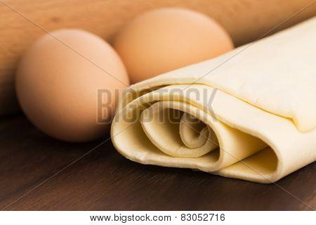 Homemade Dough On A Wooden Board