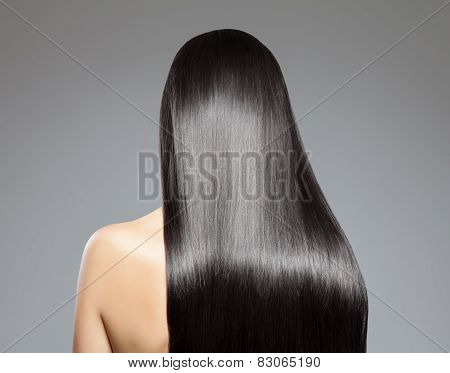 Back view of a woman with long straight hair poster