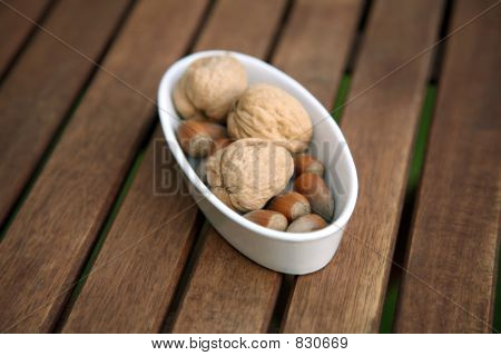 nuts in white bowl on table