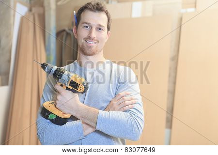 A carpenter working hard at the worksop