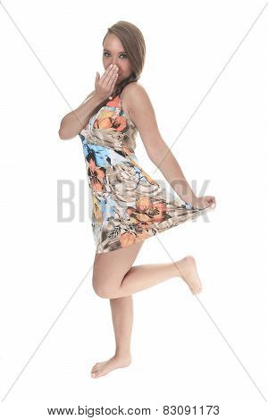 19 years old young woman with a dress in front of a white backgr