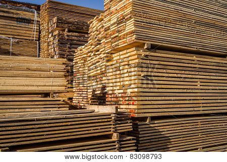 Stacked wood pine timber for furniture production and construction poster