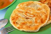 Crispy Indian roti prata cuisine with curry side dish. For diet and nutrition healthy lifestyle and Asian cuisine concepts. poster