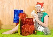 teenager girl with Christmas gifts and two pet rabbits poster