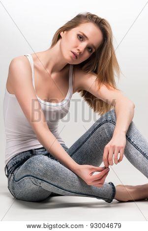 Pretty sad woman on floor