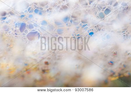 Close up of froth abstract background. Air bubbles in soap foam. poster