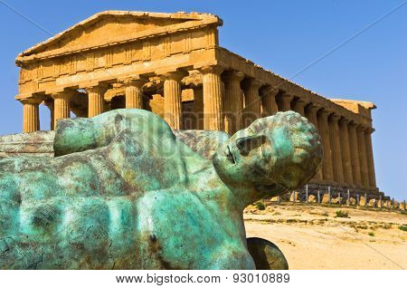 Icarus statue in front of Temple of Concordia at Agrigento Valley of the Temple, Sicily