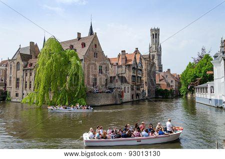 Bruges, Belgium - May 11, 2015: Tourist Visit Rozenhoedkaai (the Quai Of The Rosary) In Bruges.