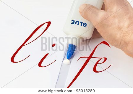 Male's Hand Fixing With Glue Broken Word Life