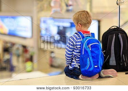 little boy with backpack waiting in the aiport, kids travel poster
