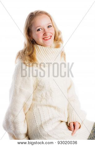 Blonde woman in knitted sweater