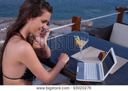 Woman On The Phone With Lap Top  Computer