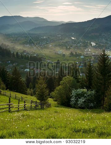 Summer rural landscape with mountains on background