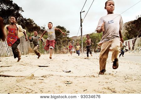 Children running in township, South Africa.