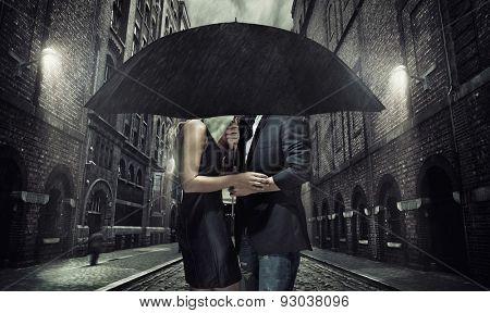 Elegant couple on rainy evening