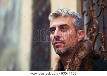 Portrait Of A Sexy Man In Wolf  Fur And Ornamental Medieval Window On Background