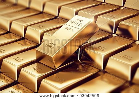 Macro view of stacks and rows of gold ingots or golden bullions bars with selective focus effect poster
