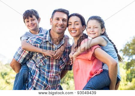 Happy family in the park together on a sunny day