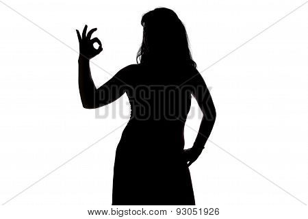 Image of woman's silhouette showing okey