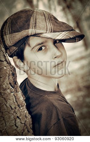 Young boy with newsboy cap playing detective