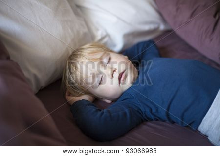 Face Baby Sleeping Between Cushions
