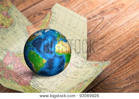 Earth in map  on wood background Elements of this image furnished by NASA