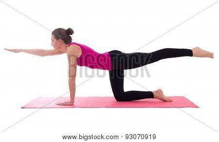 Young Beautiful Woman Doing Yoga On Pink Mat Isolated On White