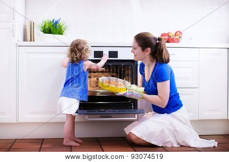 Mother And Child Baking A Cake.