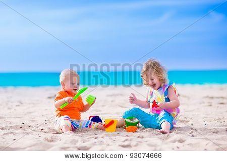 Kids Building A Sand Castle On A Beach