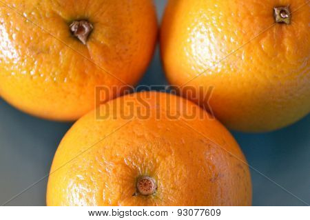 Closeup Of A Triad Of Oranges