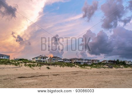 Beach Houses At Sunset