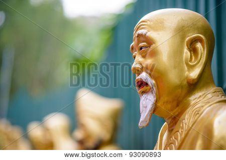 Statues at Ten Thousand Buddhas Monastery in Sha Tin, Hong Kong, China. poster
