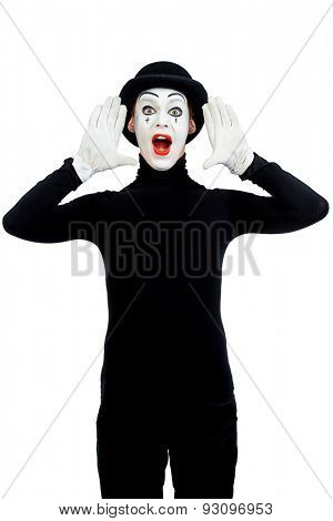 Male mime artist is shouting or calling someone. Isolated over white.